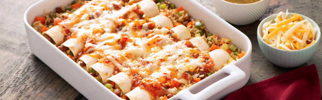 Baked enchiladas with brown rice and cheese