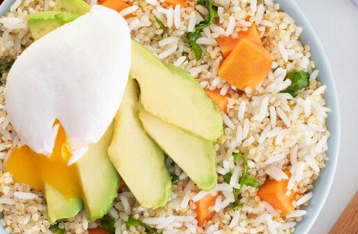 Breakfast bowl of Jasmine with Quinoa, eggs, avocado and sweet potato