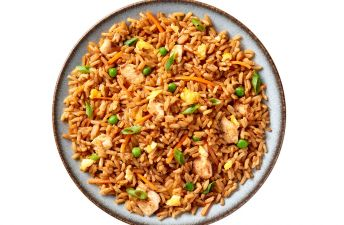 Plate of Chicken Fried Rice with peas and eggs