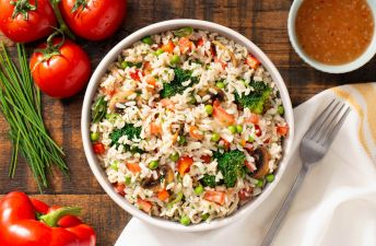 Layered Mediterranean Rice Salad with tomatoes