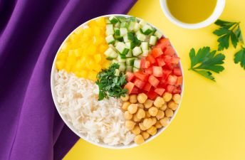 Salad bowl with Rice, cucumber, tomatoes, yellow bell peppers and chickpeas