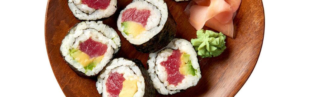 Tuna and avocado sushi rolls with wasabi