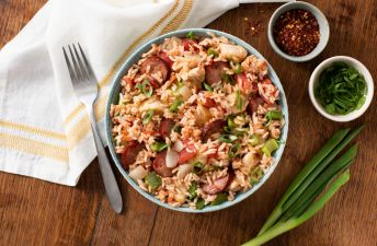 Rice bowl with spicy cajun jambalaya and sausages