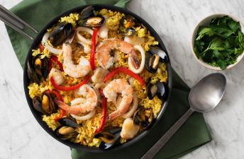 Spanish Paella with mussels, shrimps, clams and red peppers