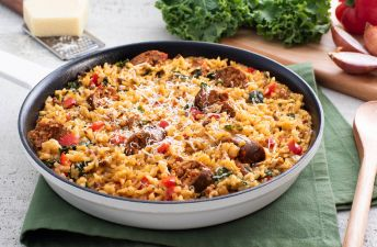 Bowl with baked jambalaya risotto and kale