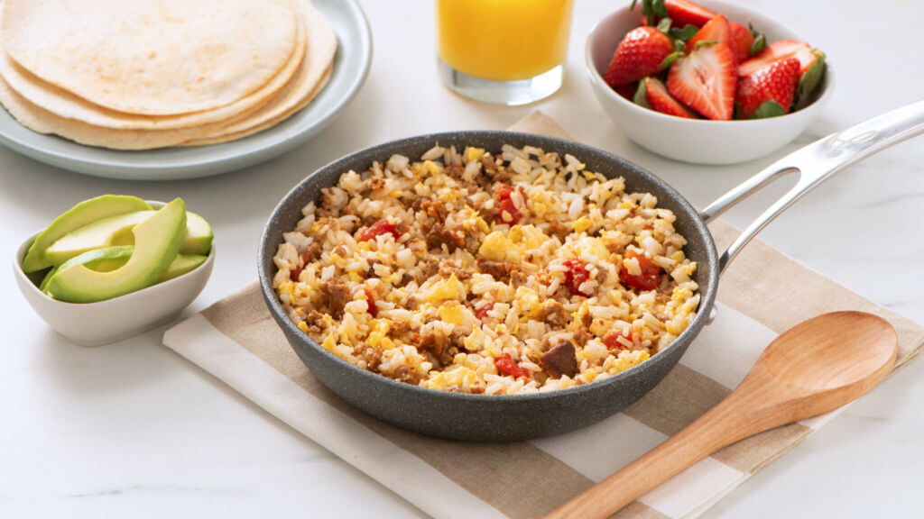 Served on a pan, chorizo and rice breakfast scramble with tomatoes