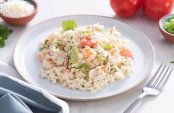 White plate with cilantro and shrimp creamy risotto