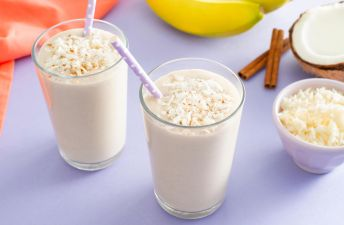 Coconut Rice Pudding Milkshake with Coconut Milk and Cinnamon Sticks