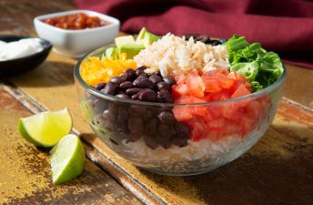 Bowl with rice, black beans, quinoa and vegetables
