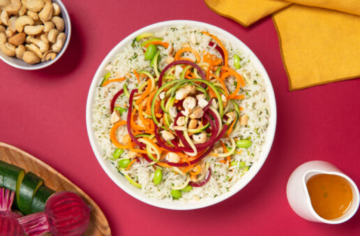 Salad rice bowl with spiralized vegetables and cashews