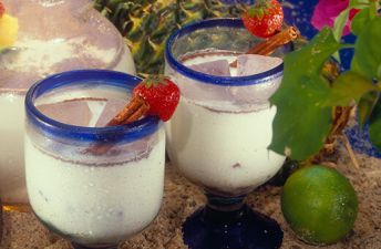 Glass filled with Horchata and topped with cinnamon and strawberries