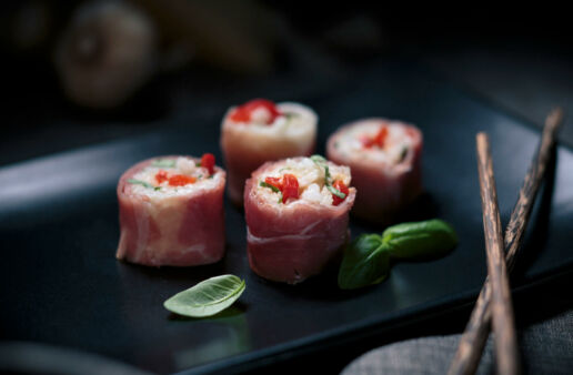 Four slices of Italian sushi with arborio and prosciutto