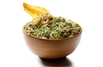 Bowl with chimichurri rice dip, spicy beef and platain chip