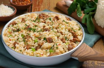Risotto dish with sausages, cauliflower and parsley