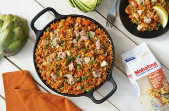 Paella with Canned Tuna and Artichoke served with lime wedges