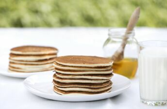Stack of rice pancakes with honey