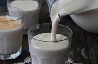pouring horchata into a glass