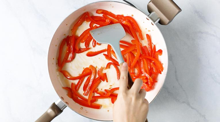 Sauteeing red pepper in a skillet