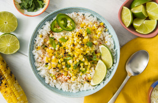 mexican-grilled-street-corn-with-white-rice-jalapenos-and-lime-wedges